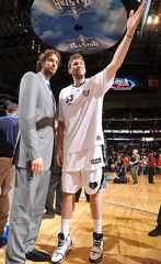 Pau Gasol in a gray suit next to his brother Marc Gasol during the NBA 2010 All Star weekend
