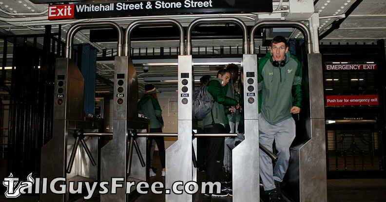 Ruben Guerrero squeezes through the subway turnstile