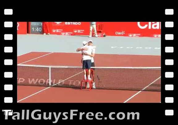 Dudi Sela uses a chair to hug Ivo Karlovic