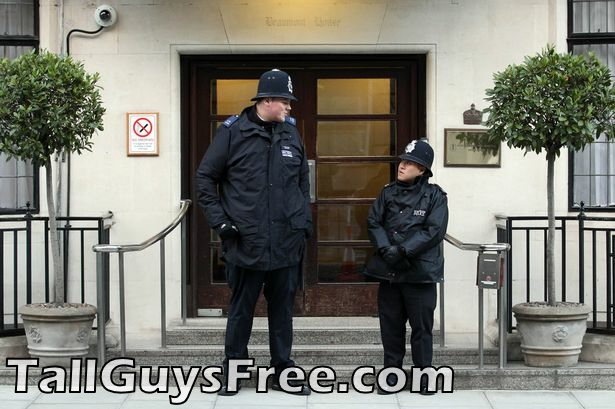 Tall and short police outside Edward VII Hospital