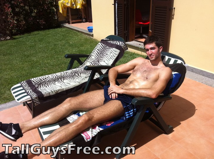 Tall guy relaxing in chair