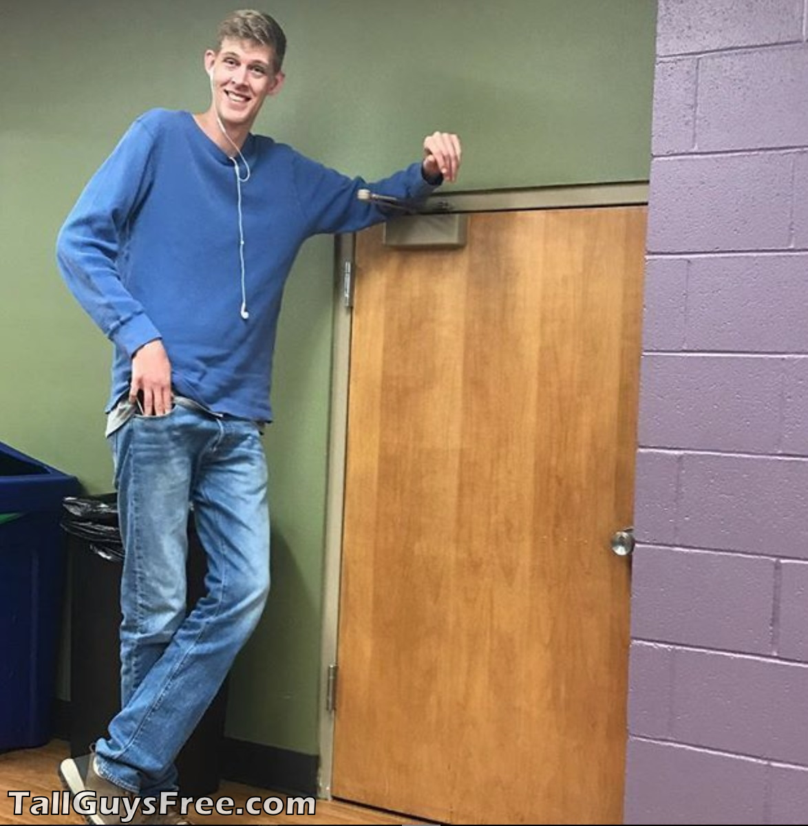 Giant lanky man doorway